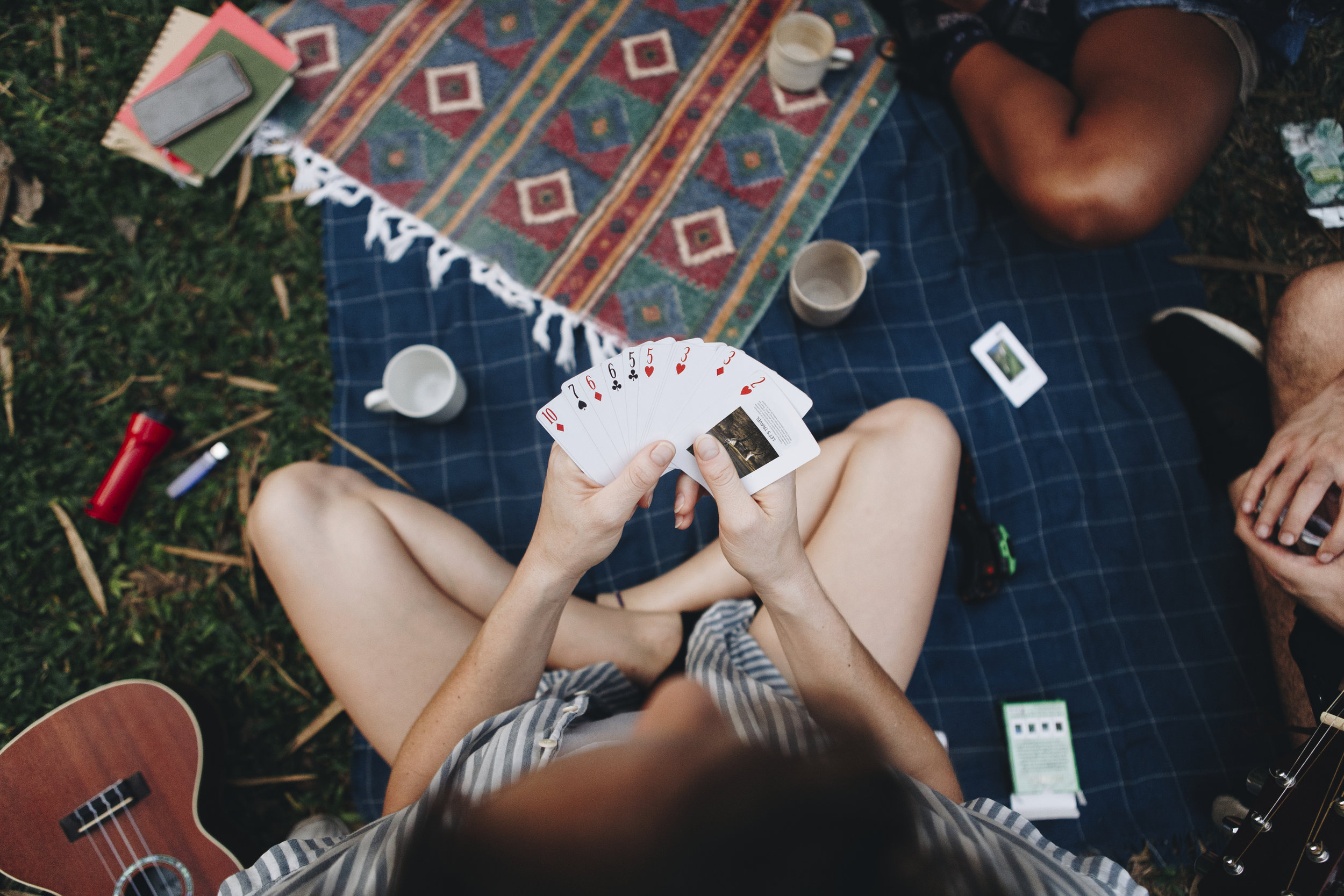 group-of-friends-playing-a-card-game-PTH6LBG.jpg