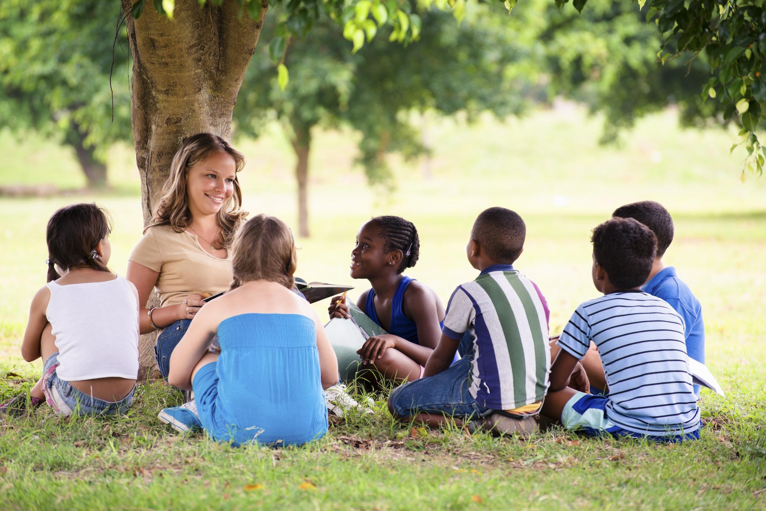 children-and-education-teacher-reading-book-to-PGWAPN8.jpg
