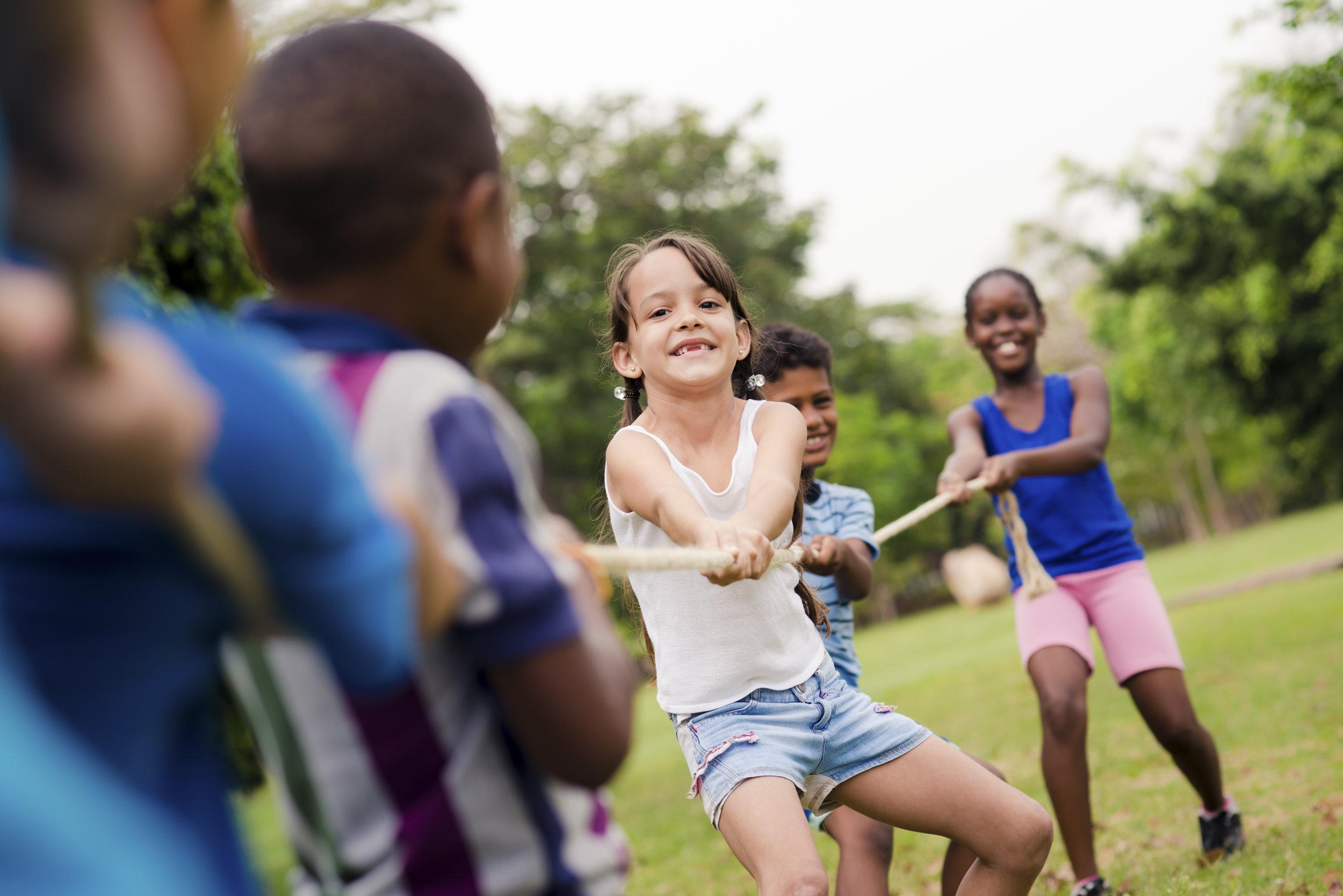 happy-school-children-playing-tug-of-war-with-PWAZQT9.jpg