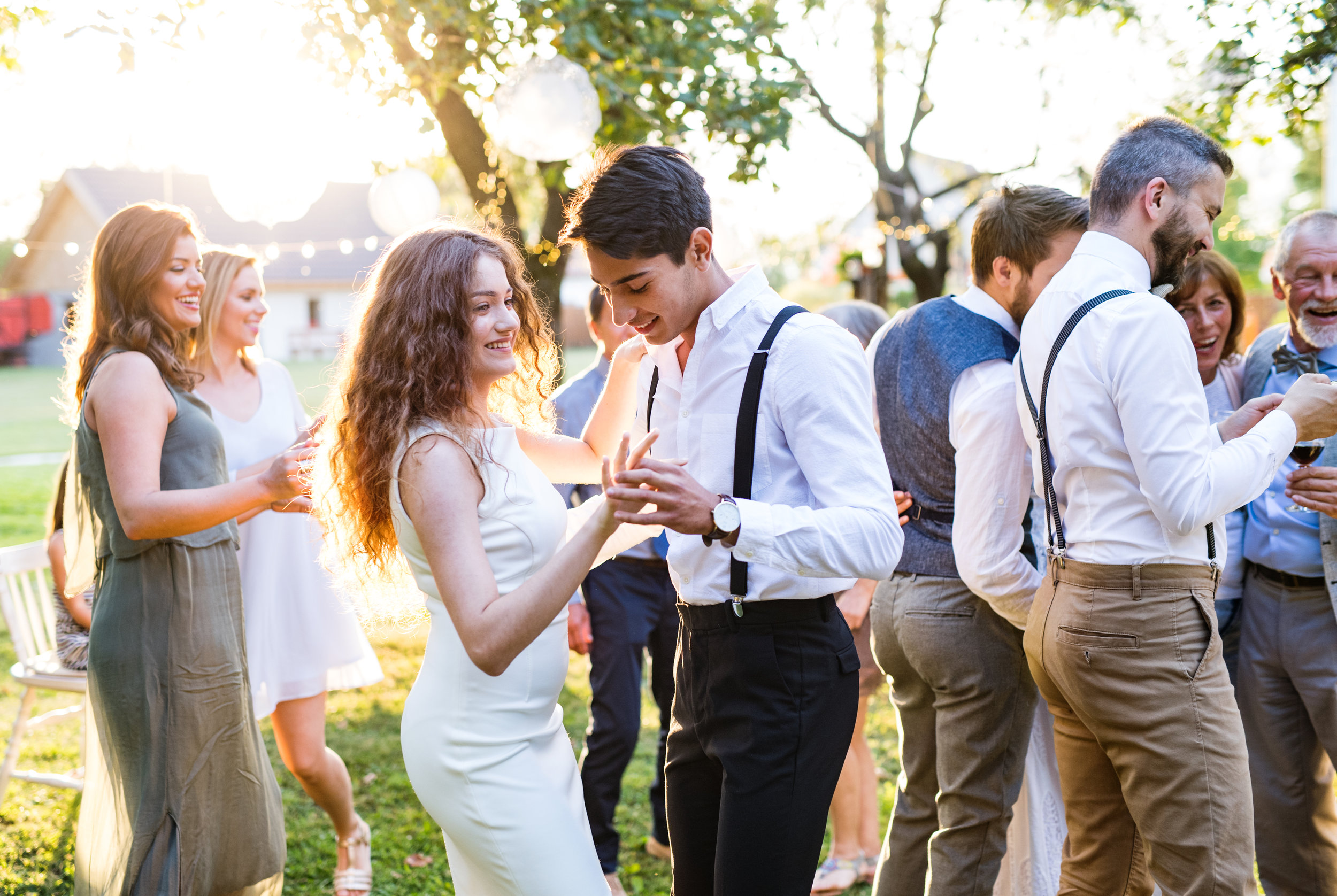 guests-dancing-at-wedding-reception-outside-in-GXEBSNV.jpg