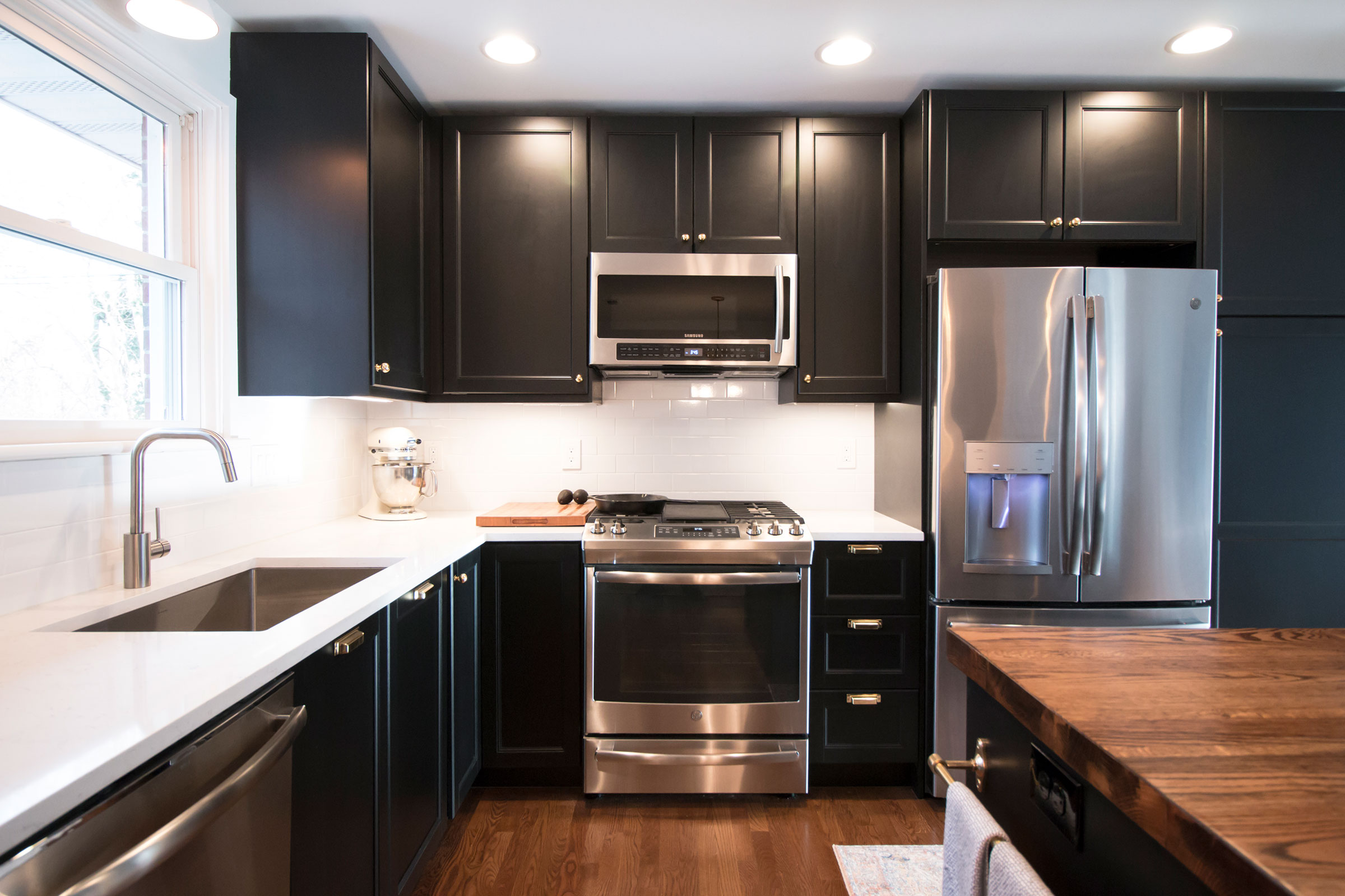 Featured Kitchen Remodel - This kitchen project was a two month project that consisted of fully gutting the previous kitchen, taking down load-bearing walls, installing structural beams, and all finish work.