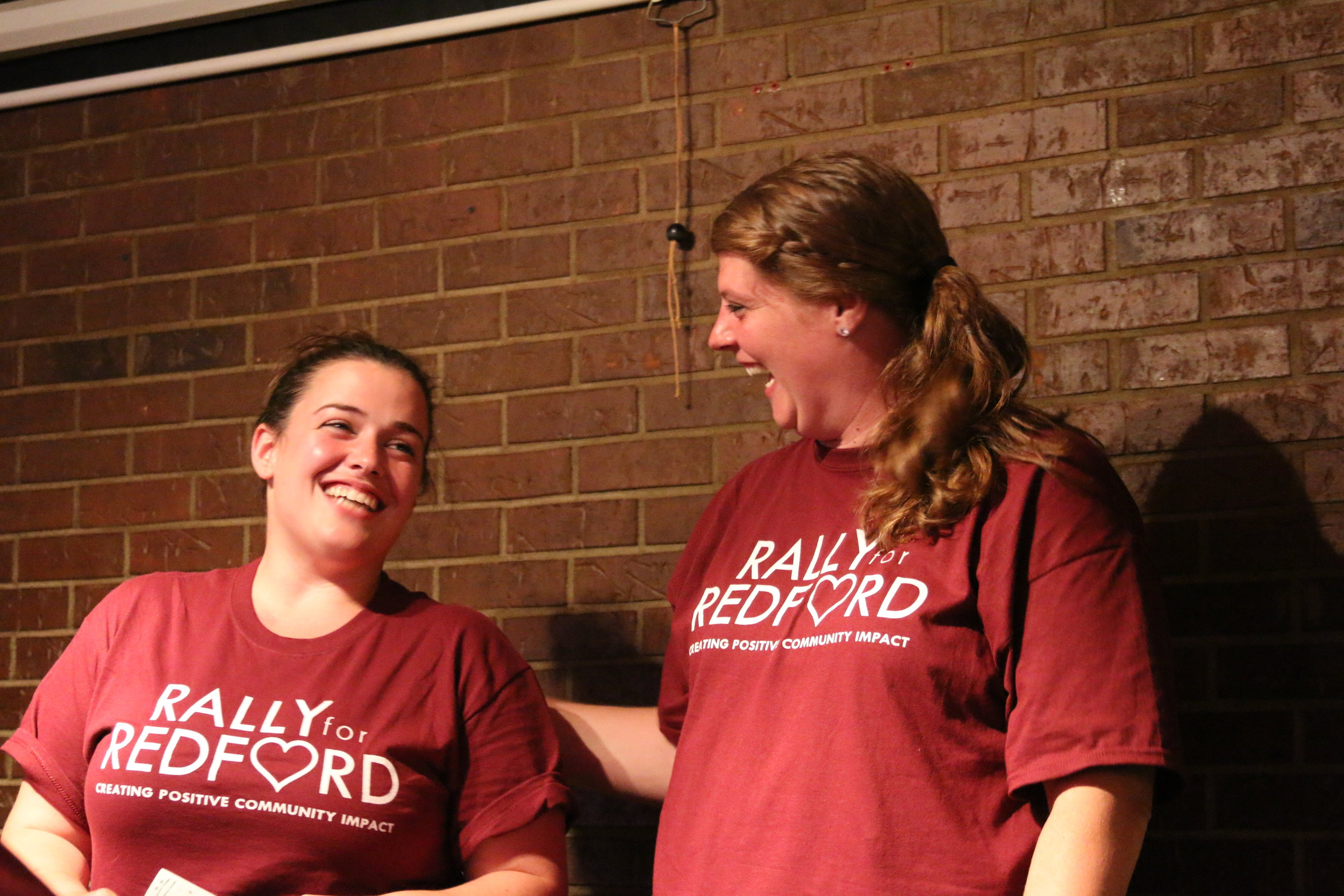 In this photo from the first rally in 2016, Susan Dials (left) and Jen Aaro (right) hear for the first time that word of their kindness rally had spread to other cities, states and countires in just a few hours.