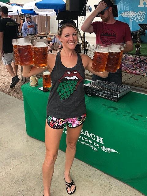 Kristen hoisting beers at Karbachtoberfest.