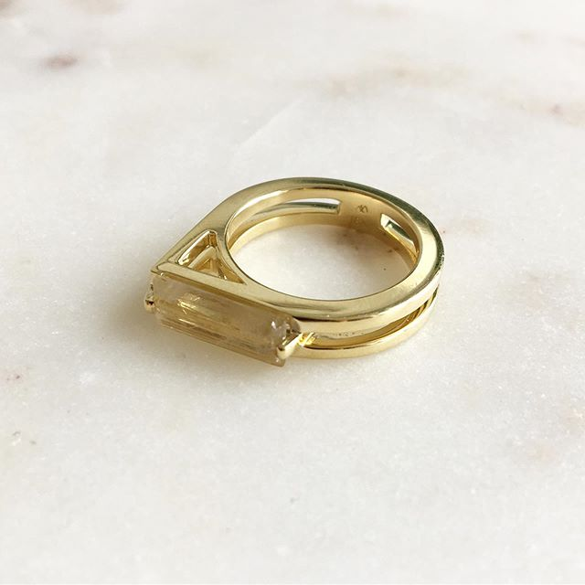 Ribbon ring in 18k gold with rutilated quartz. Love how vibrant the gold rutile in the stone is.