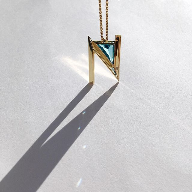 That N though... 😍 18k gold with hand cut blue topaz. #aeaidentity