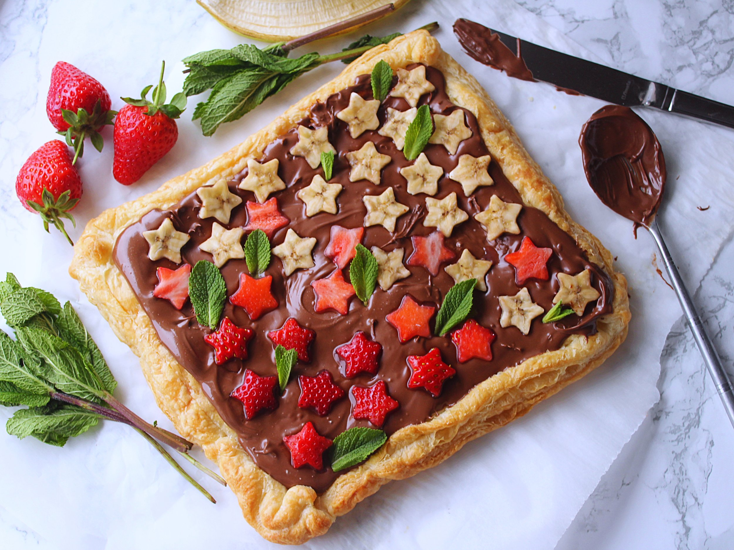 Nutella pie  - By Hungry PaprikasBake a ready rolled puff pastry dough (pricked with a fork) per package instructions. Once ready, let it cool. Then top it with Nutella and fresh fruits.