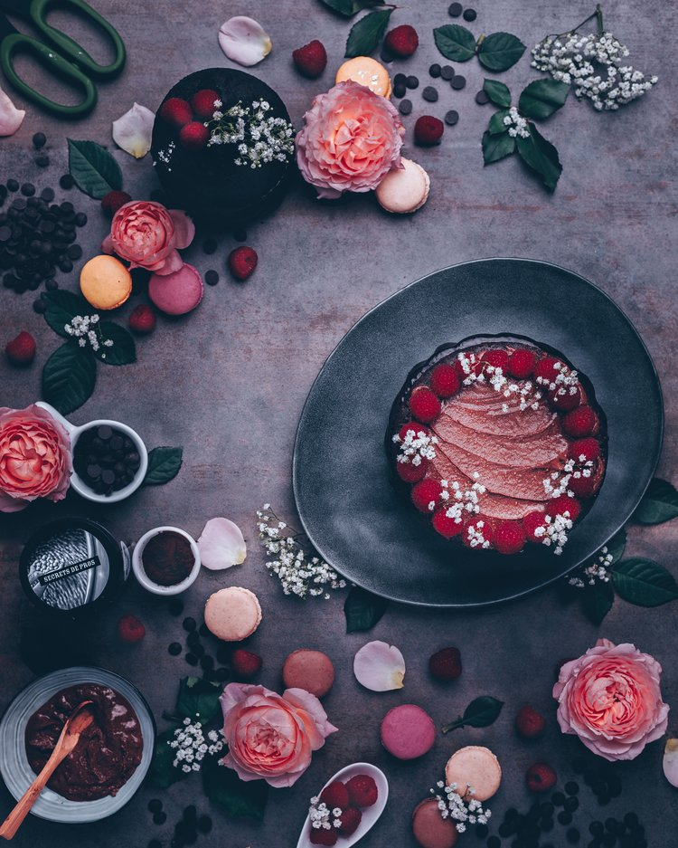 Chocolate cake with macarons, raspberries and Michel Cluizel products