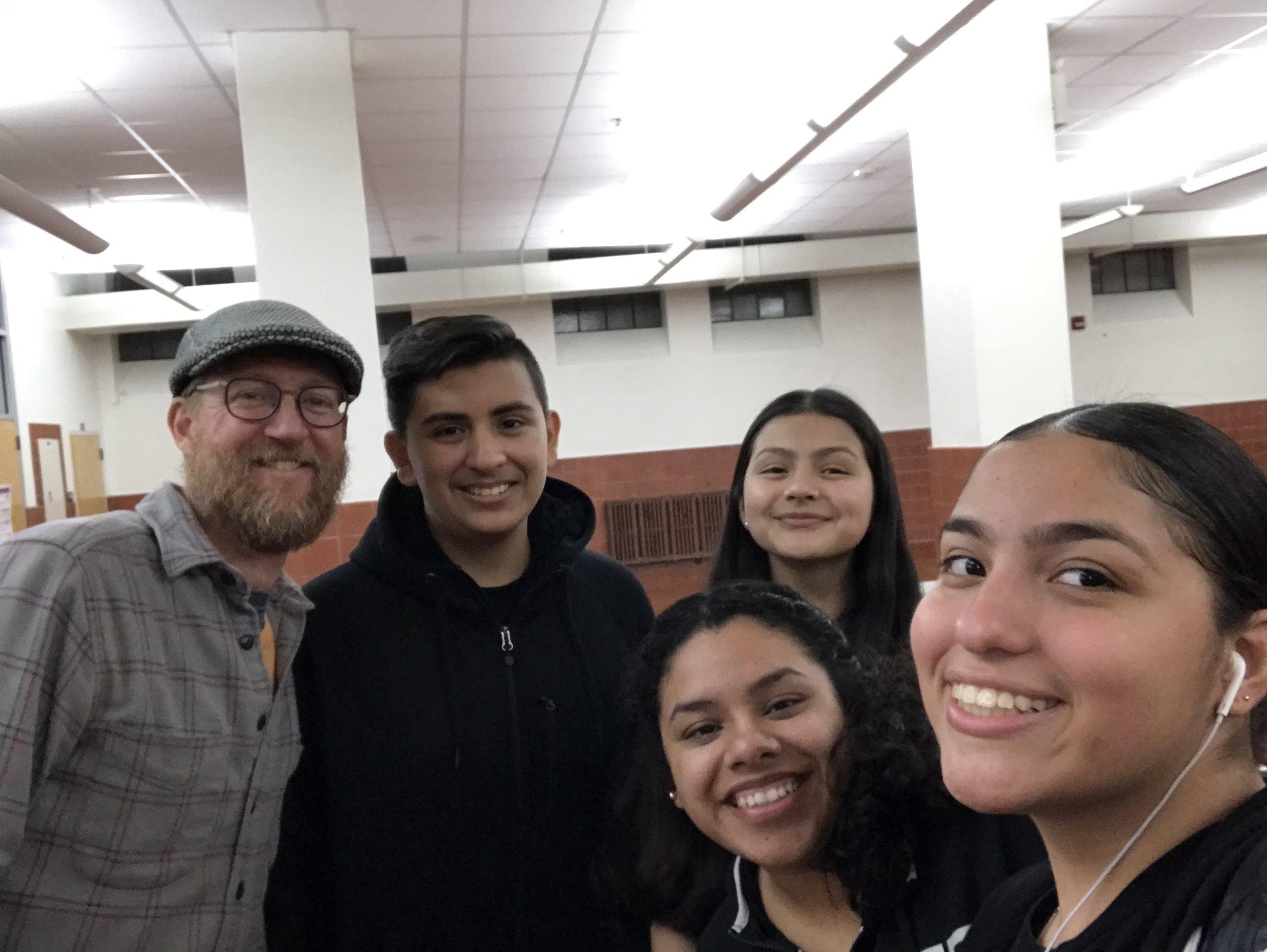 Mr. Amsler and the debate team.