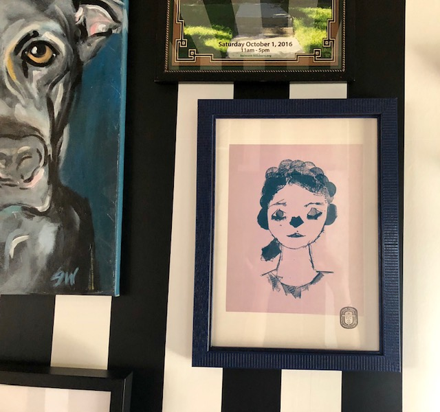 """This is a the self-portrait I have from the """"Our Town"""" project, done by a 9-year-old girl. I have it hanging in my house and love how beautiful and serene she looks."""
