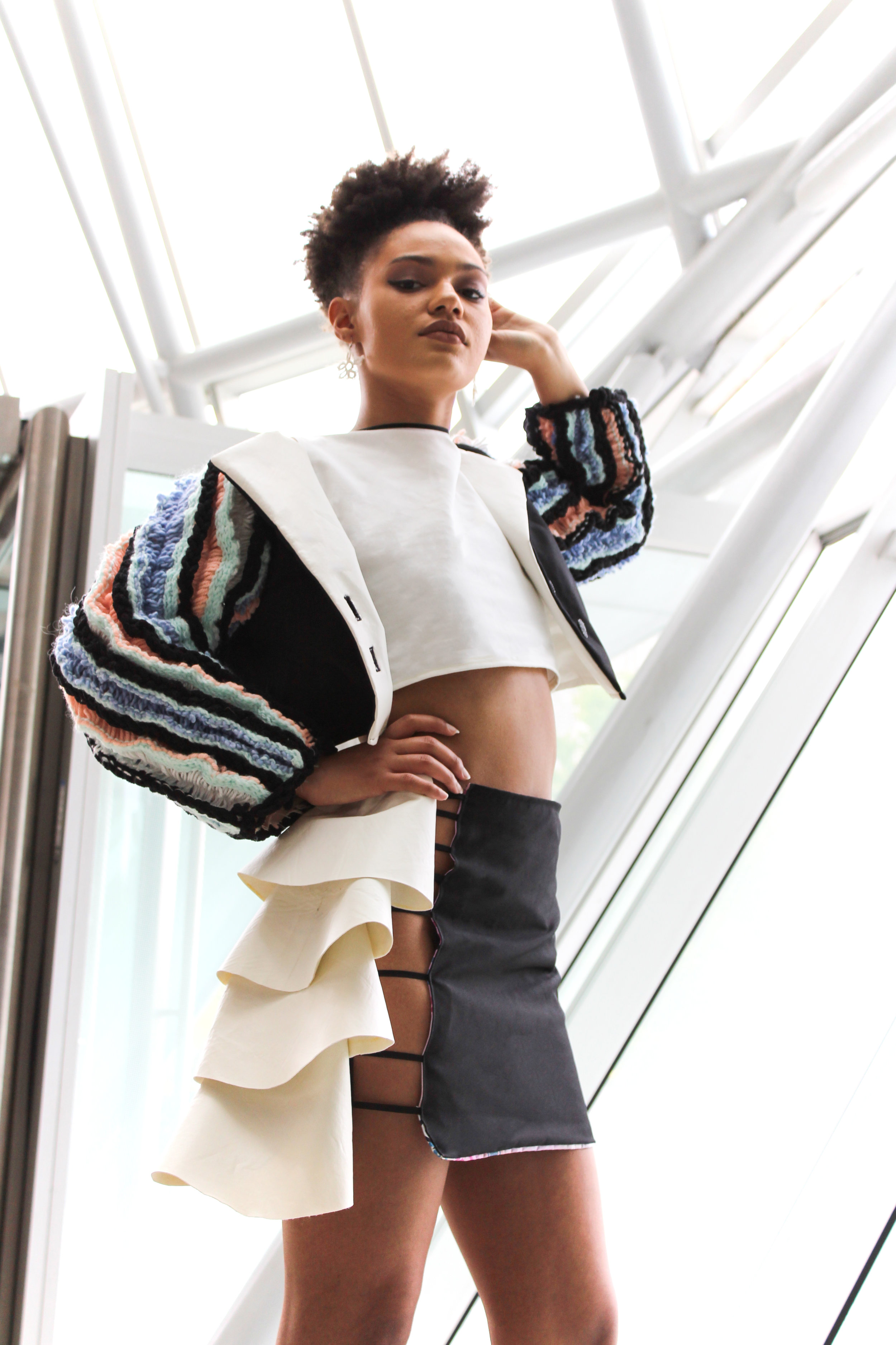 MAYA -fierce, playful, artistic - White Crop Top (cotton)Coral Arm Blazers (acrylic yarn, polyester, faux leather)Open Side Mini-Skirt (polyester, cotton, faux leather)Tatted Lace Earrings (thread floss)