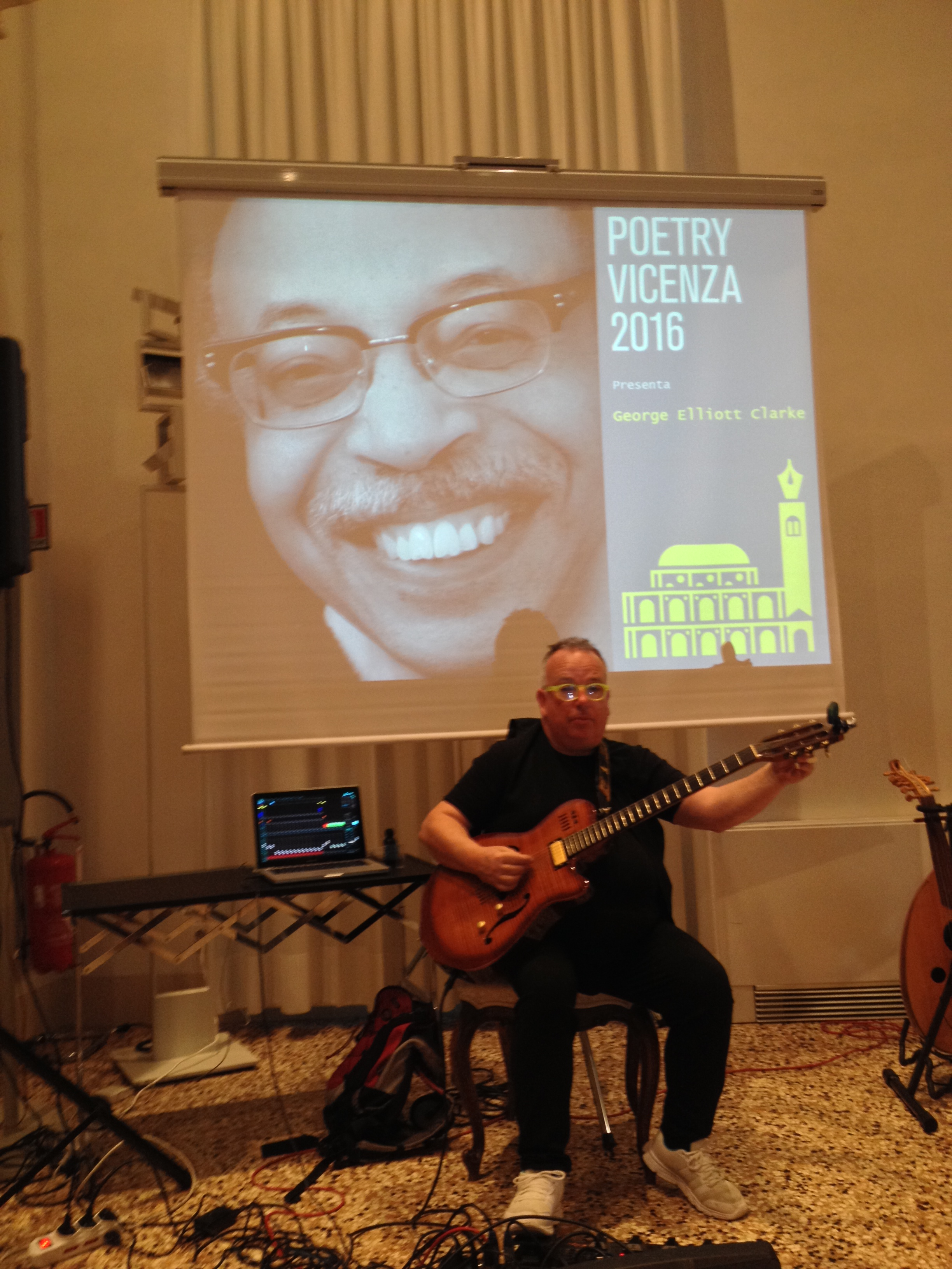 Bruno Censori backing up Clarke at Poetry Vicenza performance, 2016.
