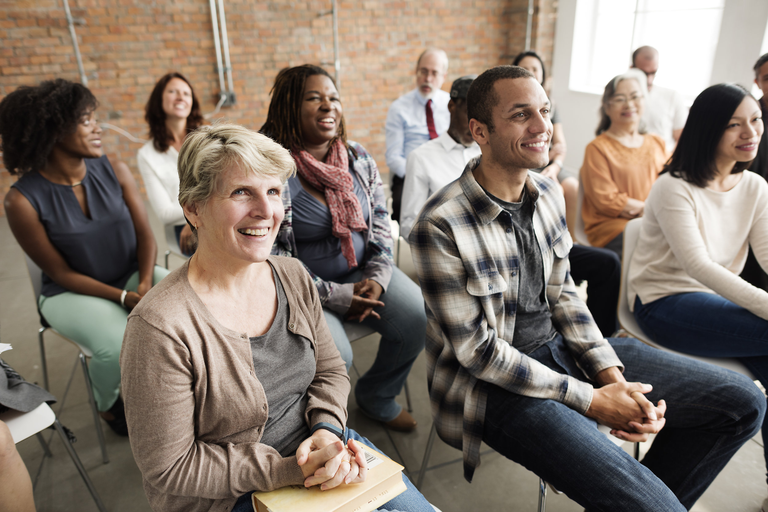 Audience smiling at a workshop