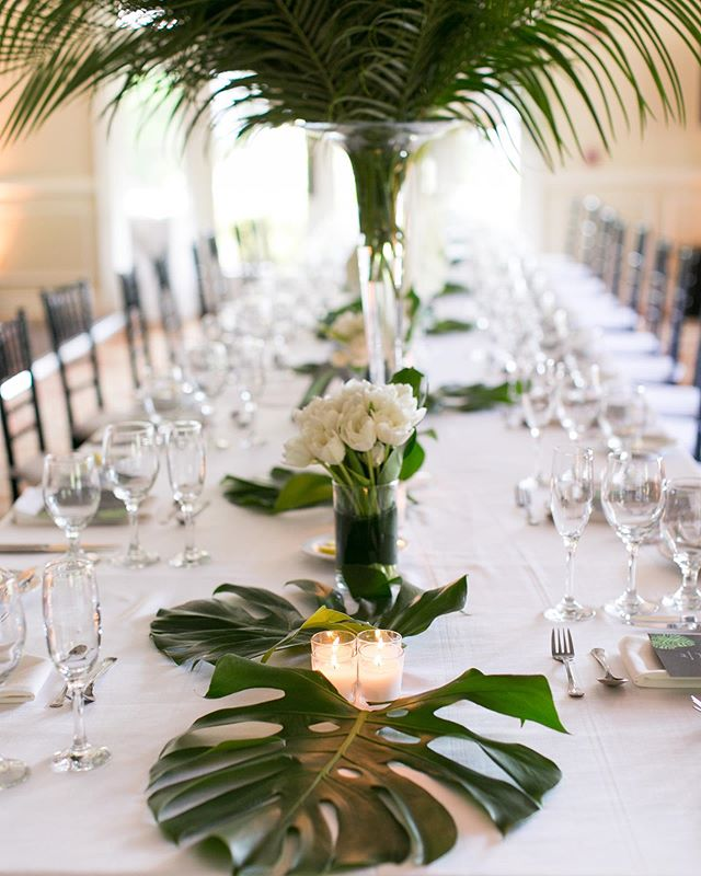 Tables dressed in tropical foliage and single element arrangements #weddingflowers #floraldesign . . . #monstera #palm #tulips #flowers #flower #flowerstagram #flowersofinstagram #charlestonstreet #floral