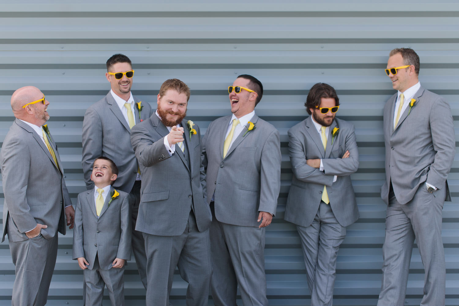 groomsmen share a funny moment as captured by tomKphoto windsong estate wedding photographer