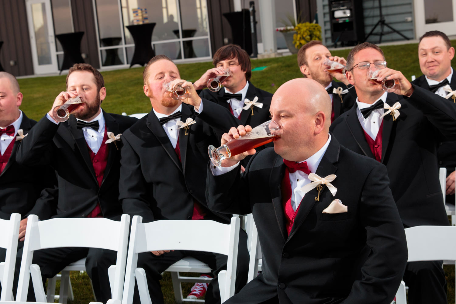 groomsmen drinking beer as captured by tomkphoto windsong estate wedding photographer