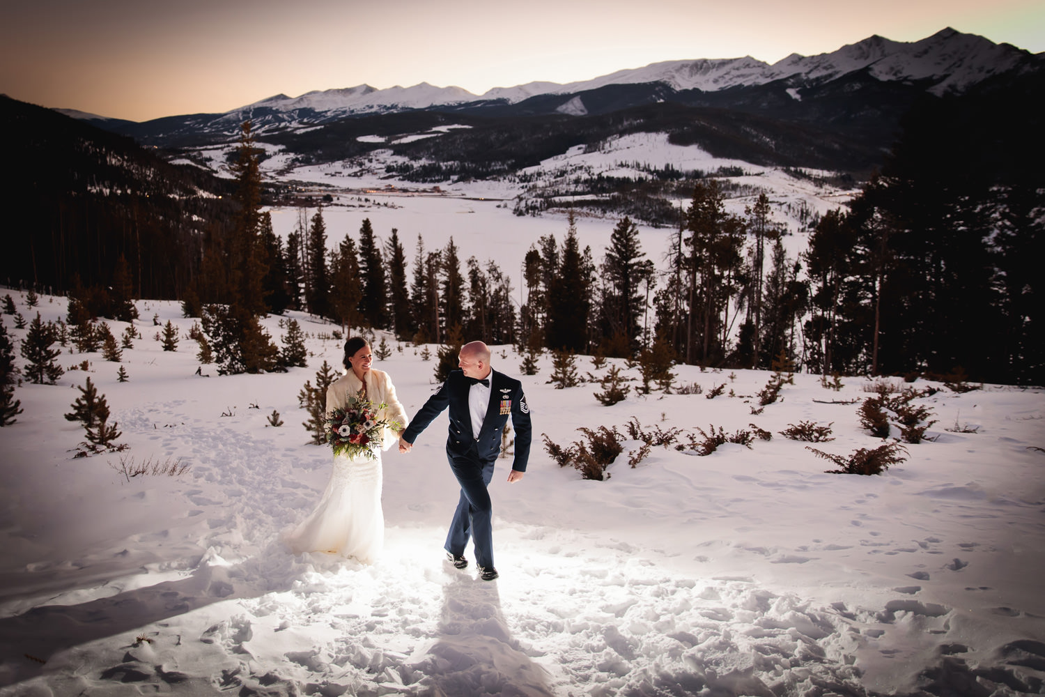 bride and groom stroll at magic light captured by tomKphoto sapphire point wedding photographer