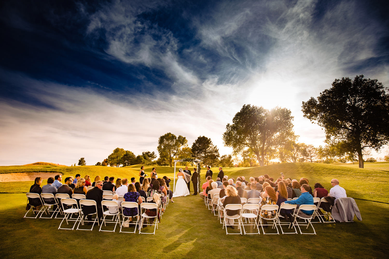 October skies glow above a Valley Country Club Wedding in Centennial Colorado