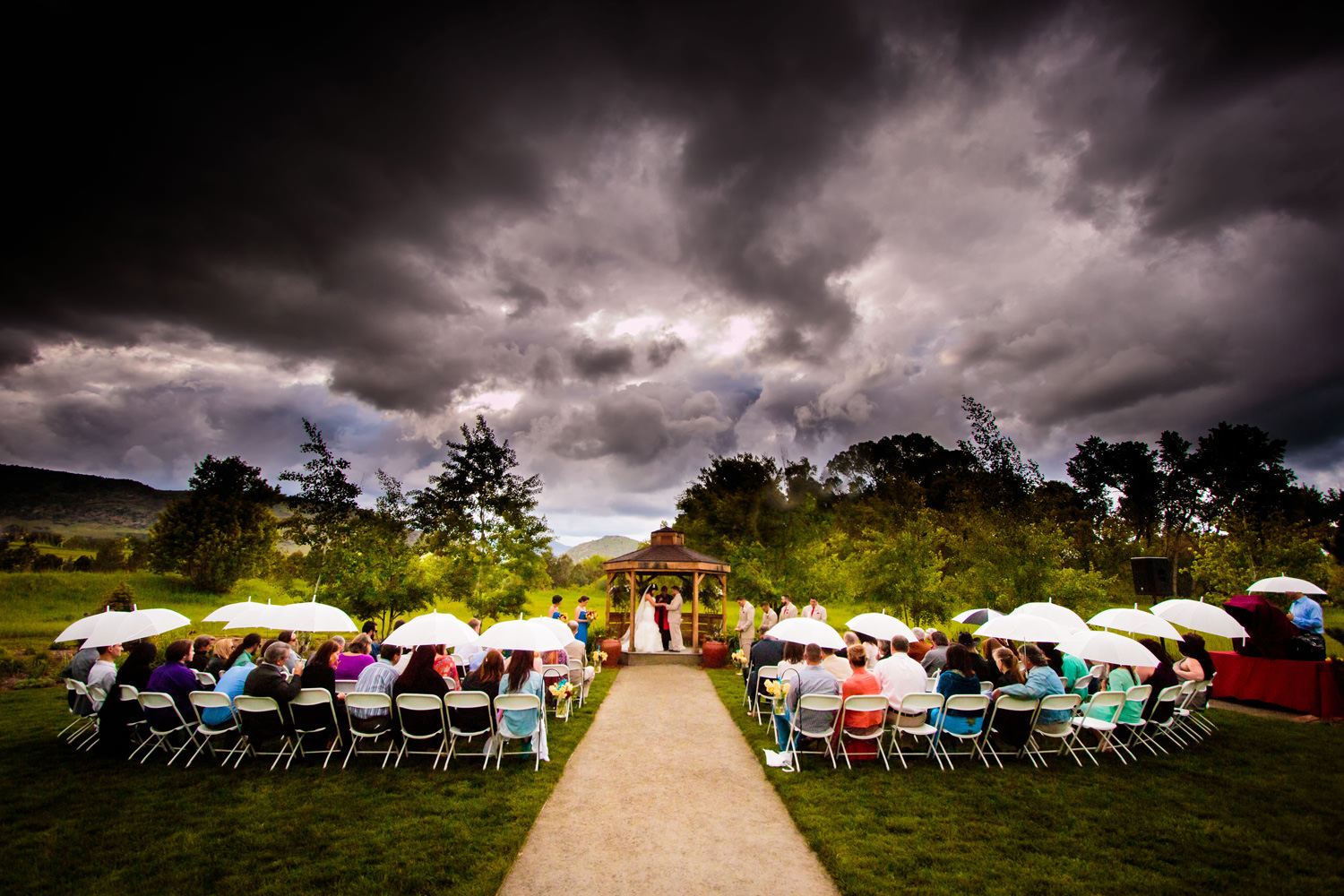 Stormy early Summer skies over a denver botanic gardens chatfield farms wedding in littleton, colorado