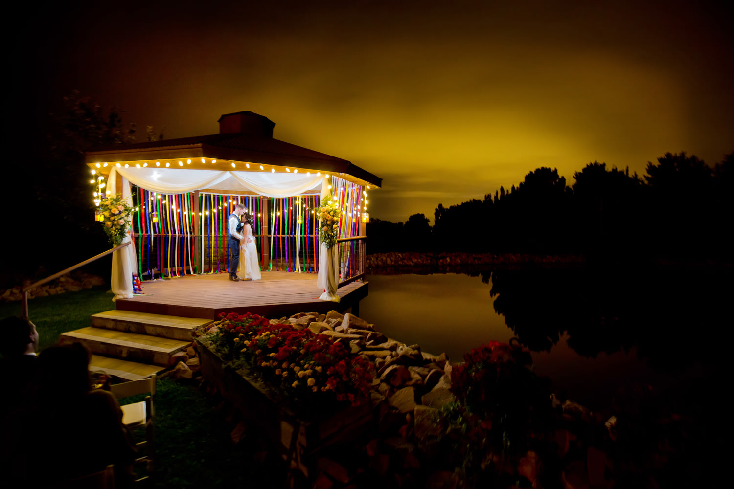 Bride and groom relax under moonlight under during a preserve and bingham hill wedding near Fort Collins, Colorado