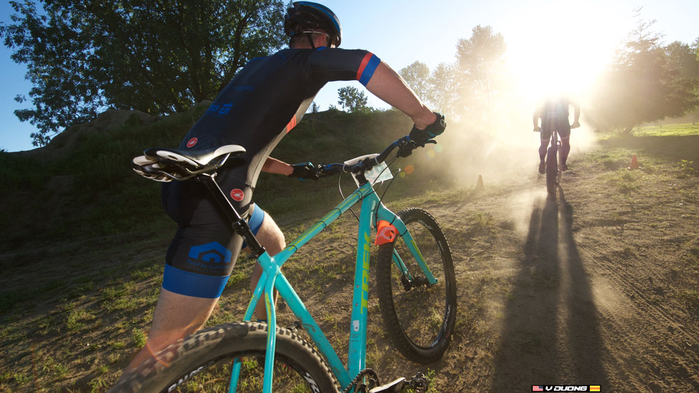josh hopping on bike with sun flare.jpg