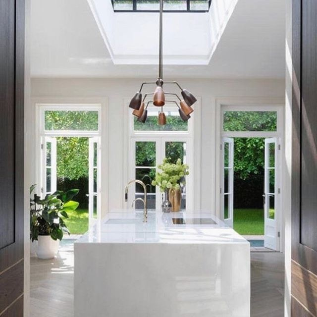 • INSPIRATION • for our new project, #projectbirkley !! We're very excited about this brand new build and are already well into the home's floor plan design. We'll be squeezing a whole lot of family living into a small block, including a statement kitchen something like this 👆🏼 - a sunlit hub of the home. We absolutely love this stage of a project, conjuring a whole home concept that's spurred on or sparked by a vision / idea / image. 💡 . . Pic via Pinterest #homedesign #newbuild #knockdownrebuild #newhome #designerhome #interiors #kitchen #kitchendesign #floorplan #layout #interiordesign #buildingdesign #skylight #frenchdoors #coastalstyle #coastalhome #classicstyle #hamptonsstyle #coastaldecor #featurelighting #islandbench