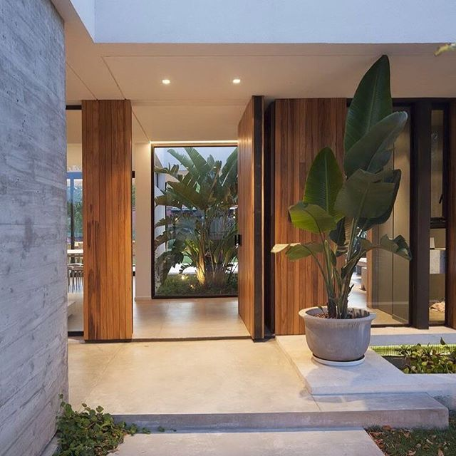Serene and sophisticated must have been the brief for this beautiful entrance. This little piece of inspo is circling around our vision board for #projectbirkley - connection with the outside at every turn and stunning timber detailing for the warmest of welcomes. ✅ 😍 . . . Pic via Pinterest #dreamhome #entrance #homedesign #frontdoor #homeinspo #coastalhome #internalcourtyard #landscaping #buildingdesign #designerhome #timber #modernhome #interiordesign #newbuild #homebuilding #entry #streetscape