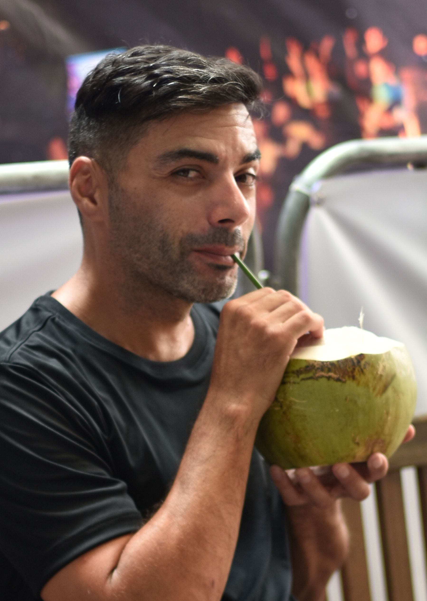 Fernando cooling off with his trademark coconut juice