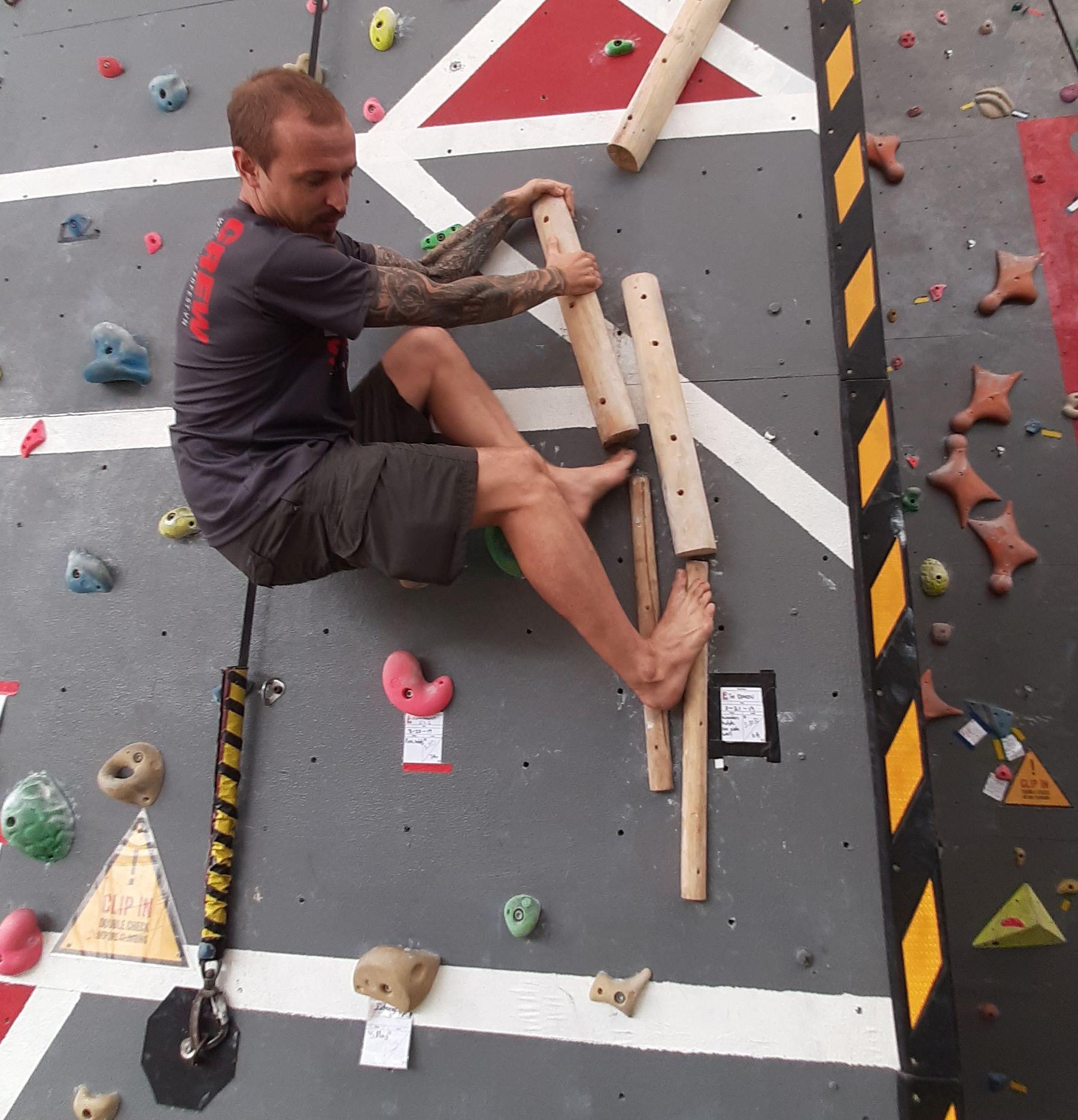 Chris climbs kraken.jpg