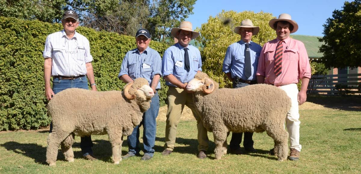 Boorooma stud, Walgett, bought three rams including the two second-top-priced $6000 Merino rams. Pictured id Boorooma classer Robert Campbell, owner John Wheaton holding one with HR stud manager, Andy Maclean holding the other, HR principal, George Falkiner and Brett Smith, Elders, Walgett.