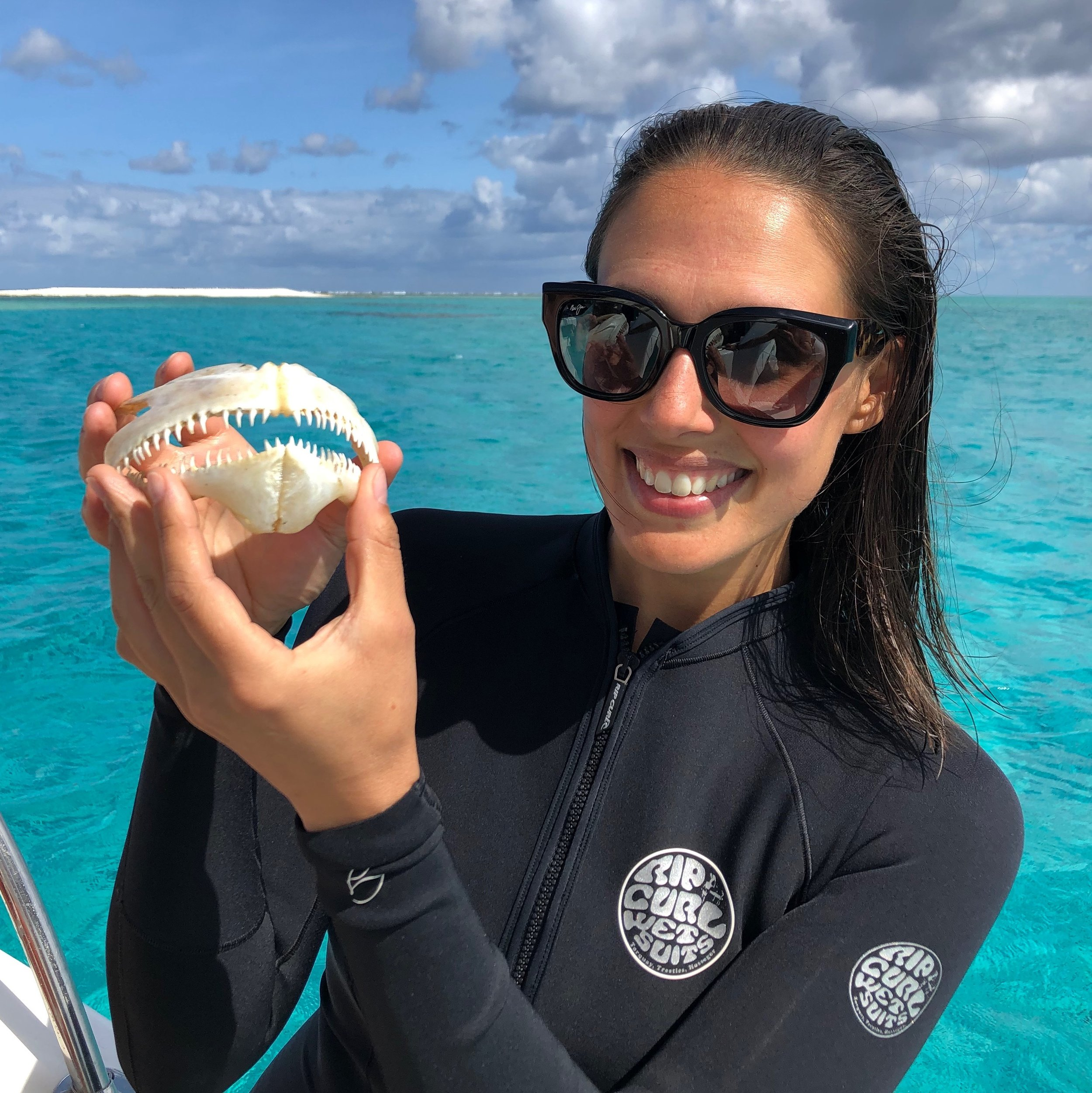Marine biologist in the Coral Sea. - Vanessa pictured here with a dogtooth tuna jaw.
