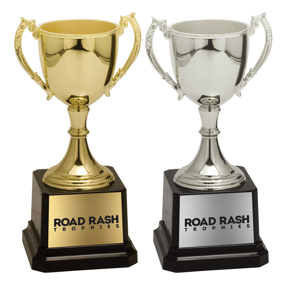 Name: 600 Series Zinc Metal Cup and Riser With Weighted Black Plastic Base.  Size/Price: 6 3/4″ – $29.99  Size/Price: 8 3/4″ – $41.99  Size/Price: 11″ – $69.99  Size/Price: 12 3/4″ – $89.99  Size/Price: 16 3/4″ – $146.99  Size/Price: 18 3/4″ – $199.99  Colors: Gold / Silver