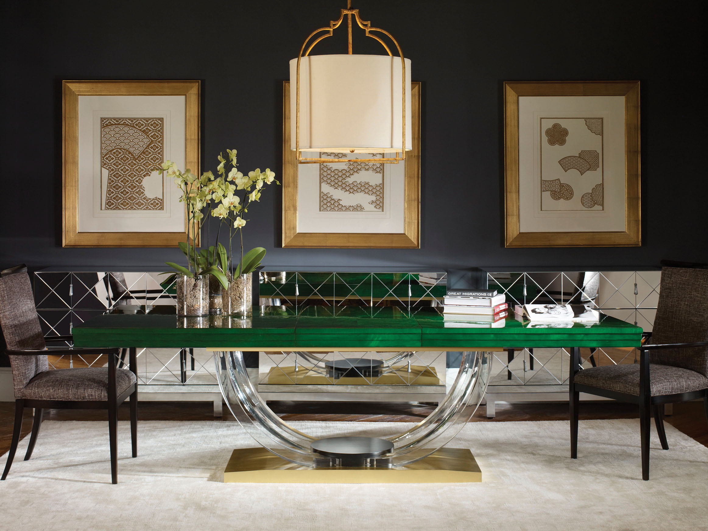 Mid-century modern is still popular, but the look is softening, well illustrated in this clear acrylic table base that gives the emerald top a floating illusion. The modern drum shade on the ceiling fixture is wrapped in a more traditional cage, juxtaposing two worlds into one cohesive look.