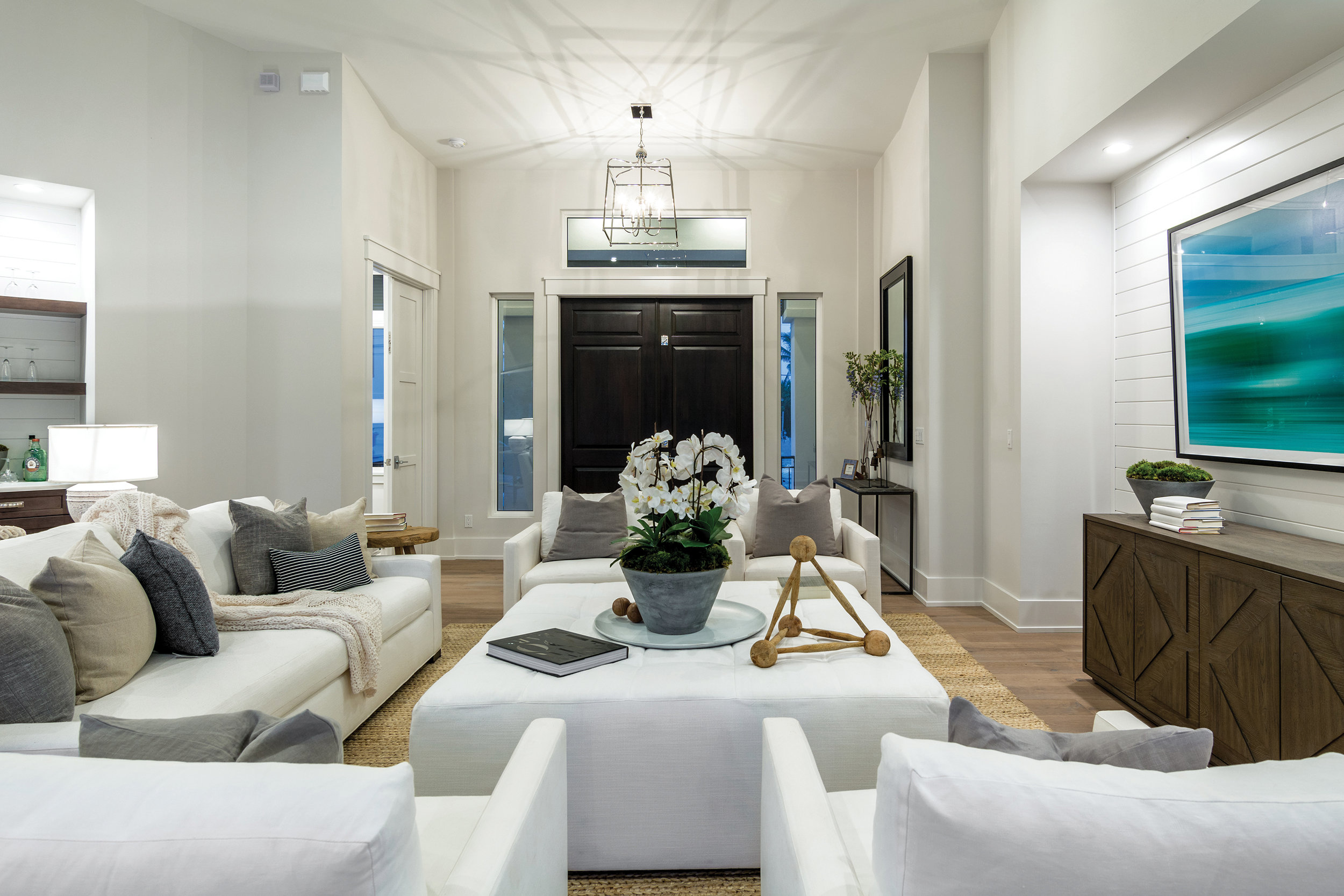 As you enter the the home through the updated foyer, new lighting makes the home feel open and bright.