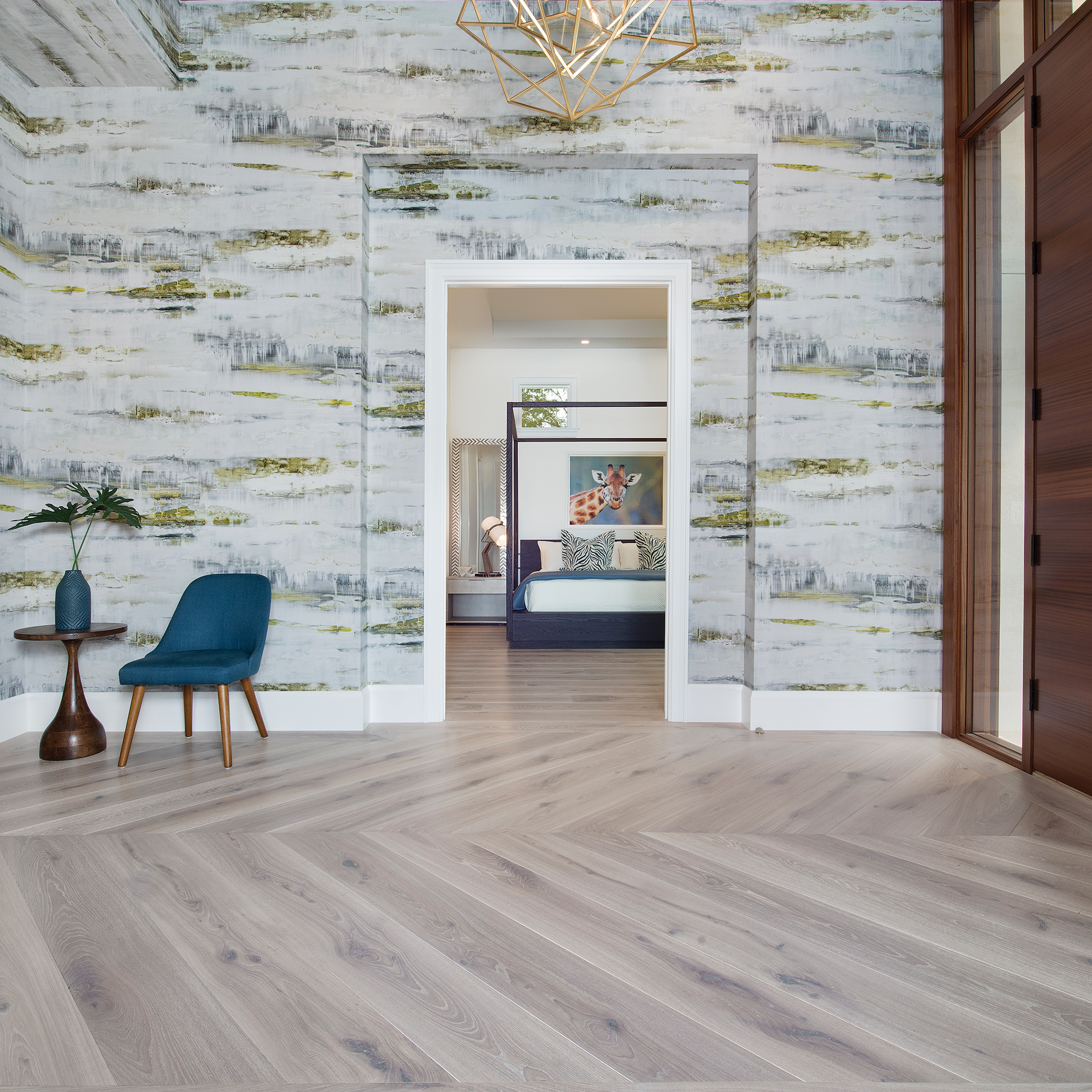 The foyer is a great place to use a chevron wood floor. It can be used with a border, as shown here, to create a transition into your home and to set the tone for the rooms beyond.