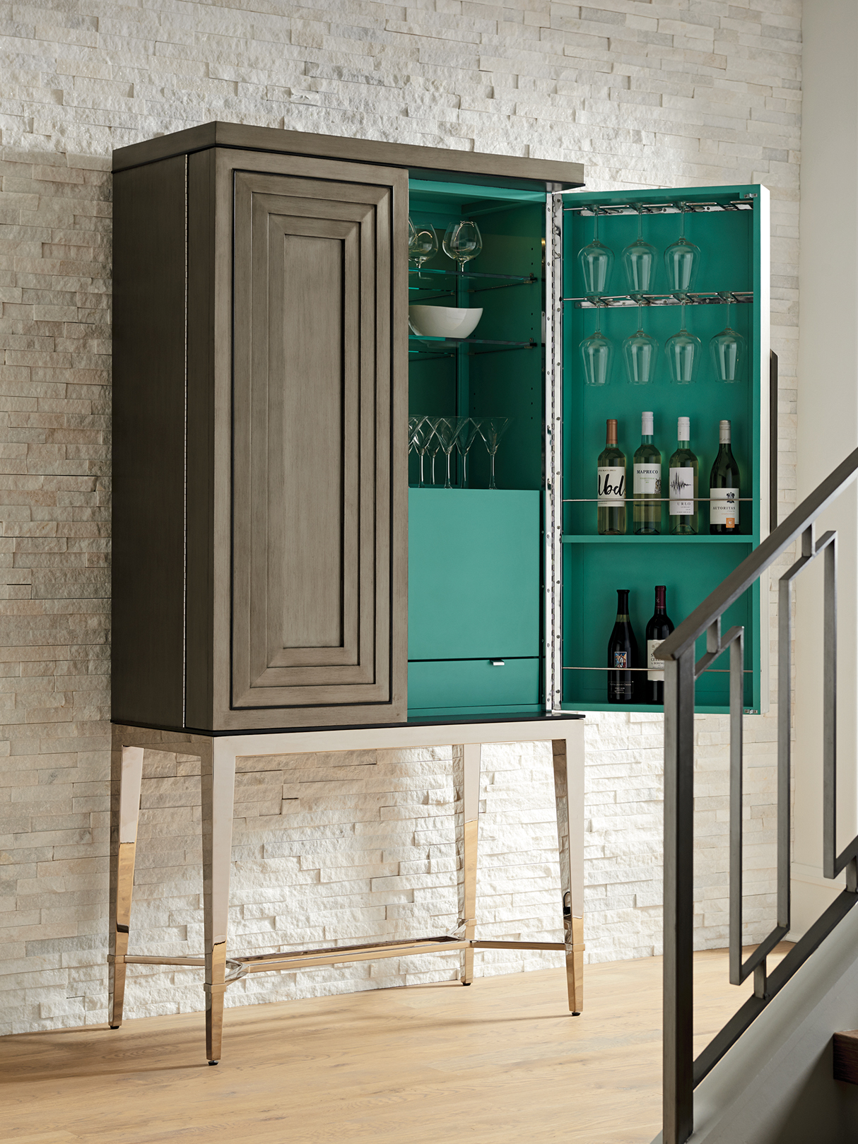 Make the most of your entertaining space by storing bar items in beautiful furniture-like pieces. When not in use, they enhance the look of your room and then open up to provide the perfect drink station when the party gets going.