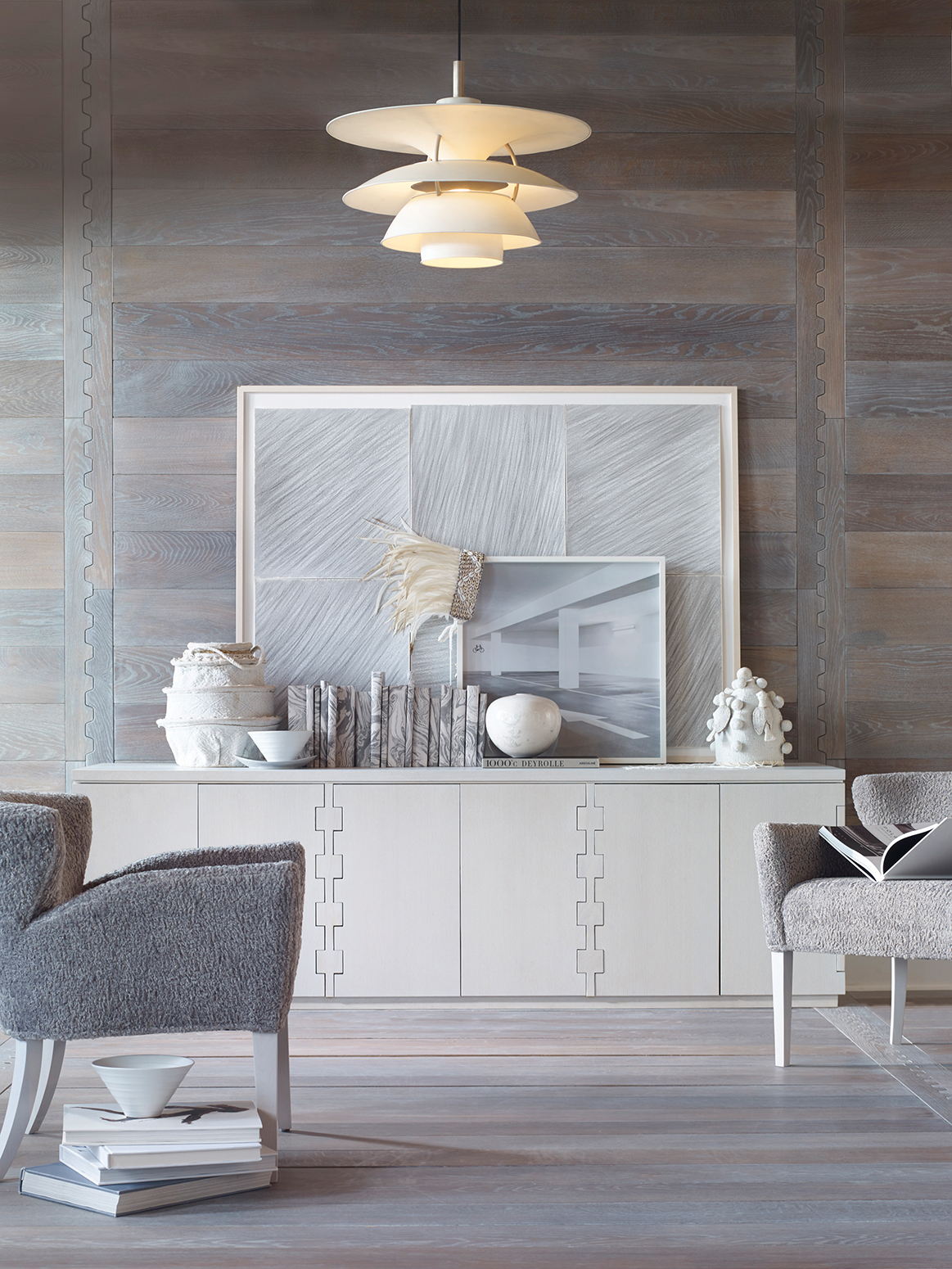 With walls, floors, upholstery, and accessories all soothing shades of neutral gray, the emphasis in this vignette is on shape and texture.