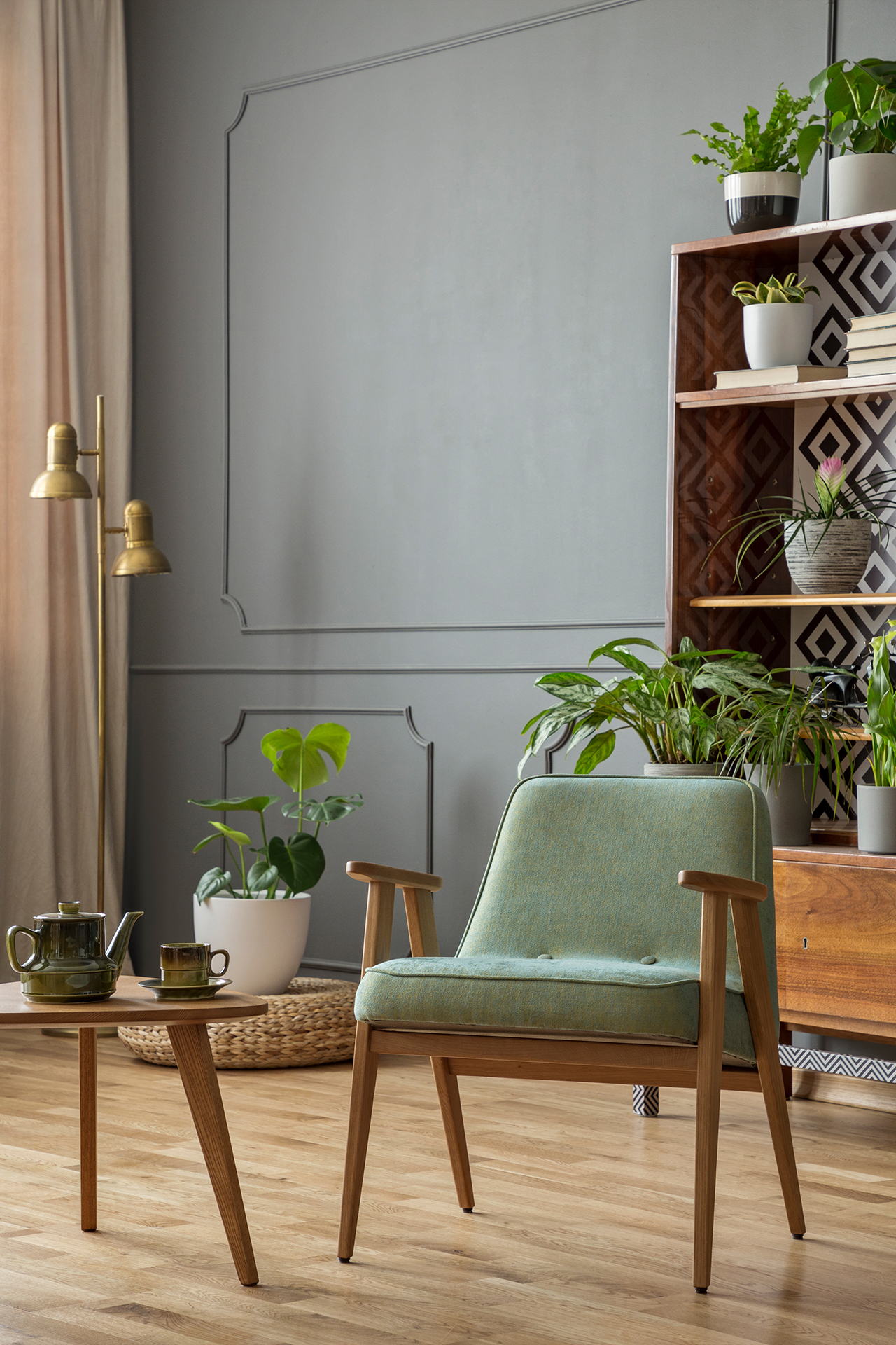 green-armchair-next-to-wooden-table-in-grey-JX2UV8S.jpg