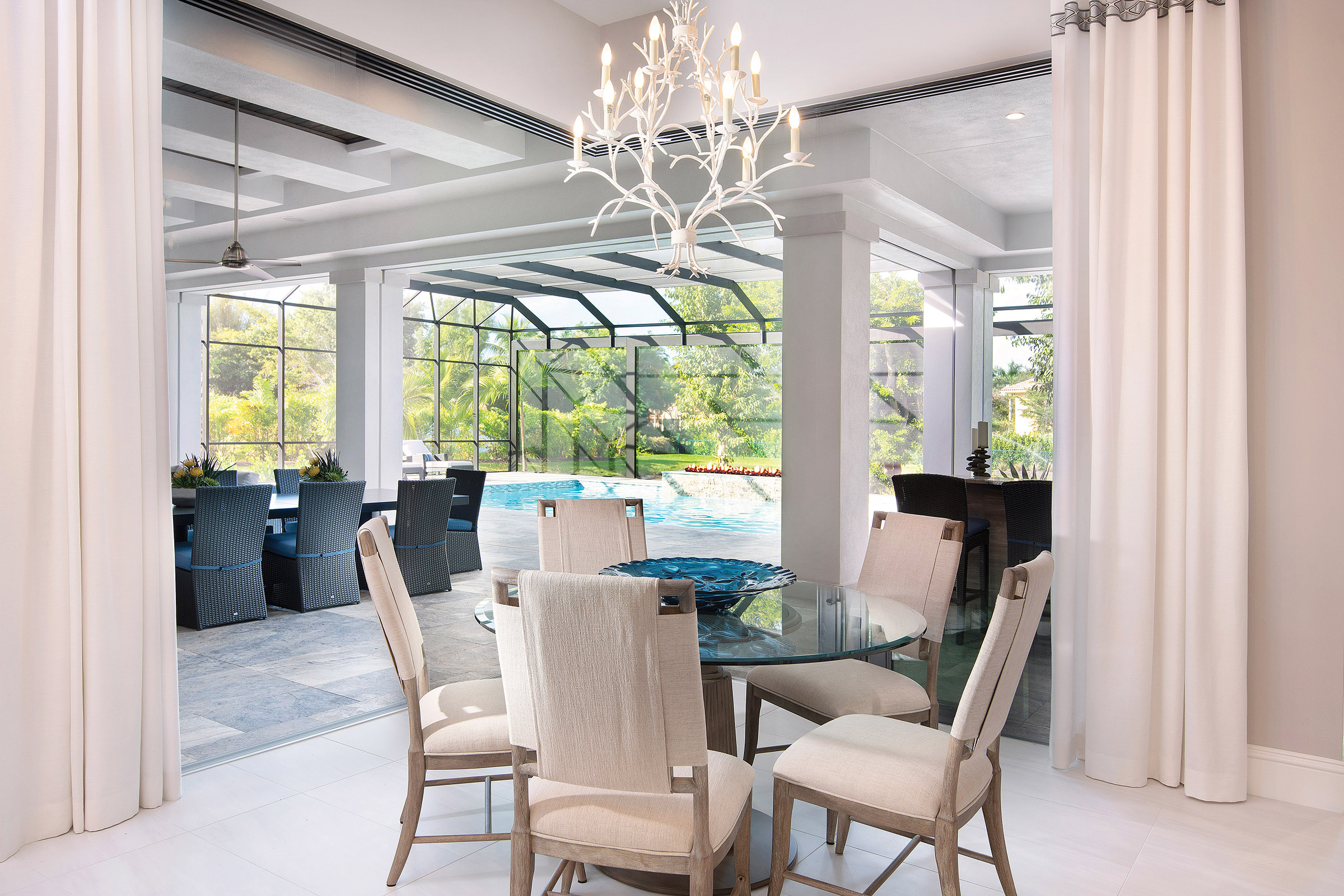 Just off the kitchen is a comfortable breakfast nook that opens into the large lanai via the corner glass doors that fully pocket away for a true indoor/outdoor dining experience.