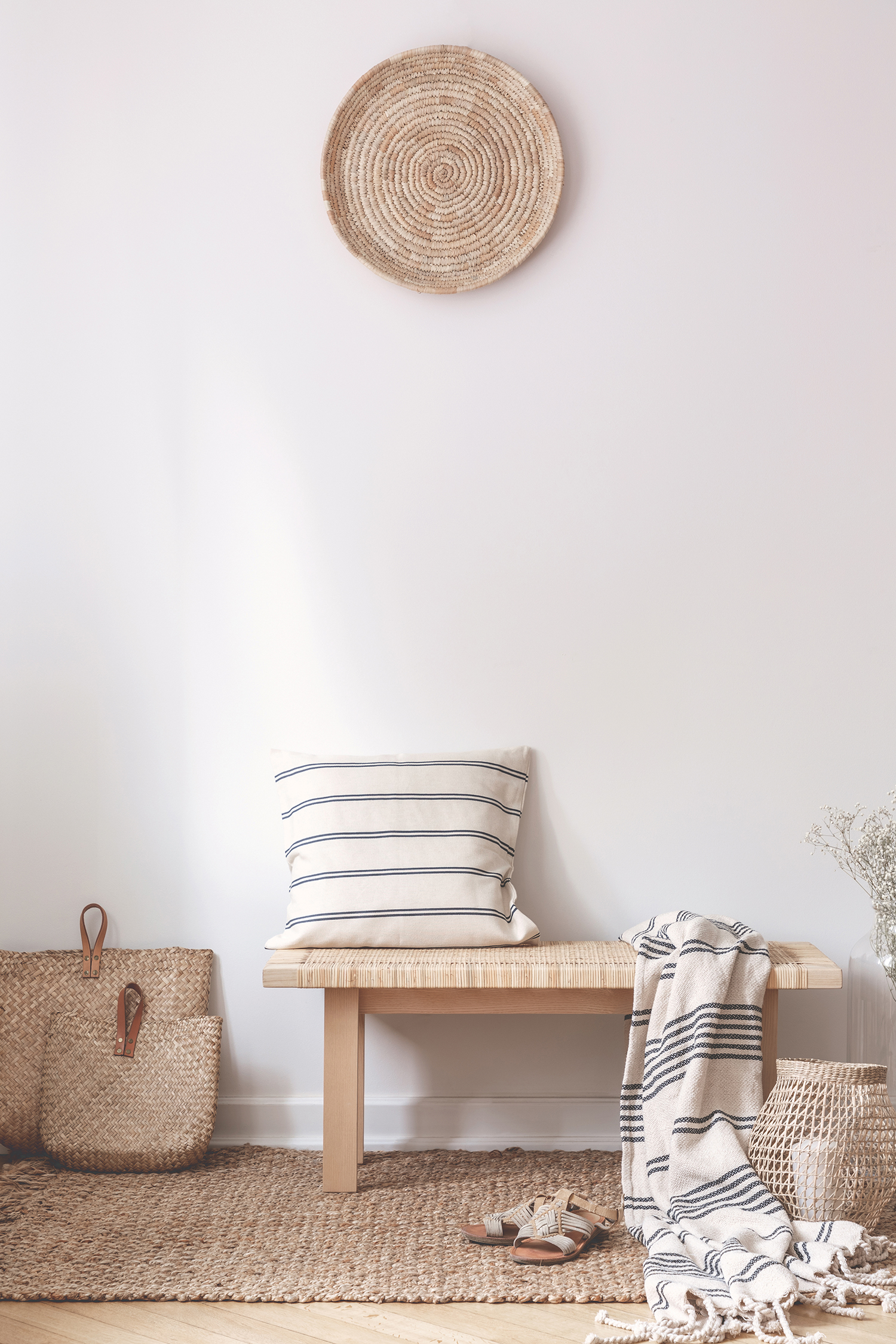pillow-and-blanket-on-wooden-stool-in-white-5AGUDWR.jpg