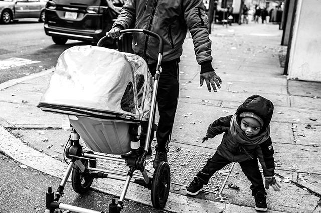 """Wait!  Wait!  Wait!"" His father had trouble keeping the fast moving youngster from darting across the street. 