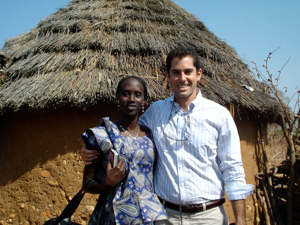 Ryan Boyette in front of his home in the Nuba Mountains of Sudan with his wife, Jazira.