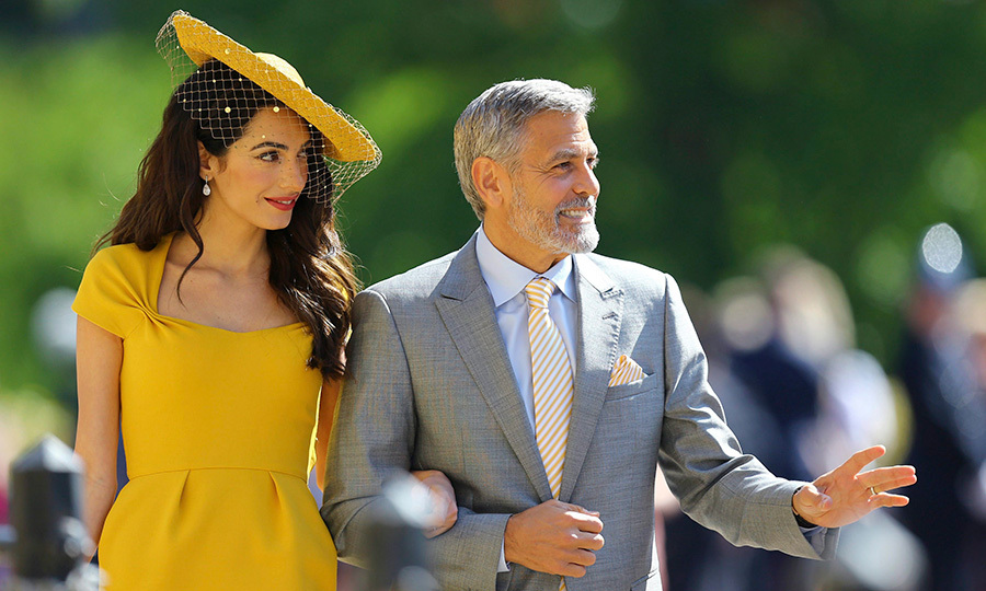 Amal Clooney arriving with her husband in a Stephen Jones hat  Image: The Associated Press