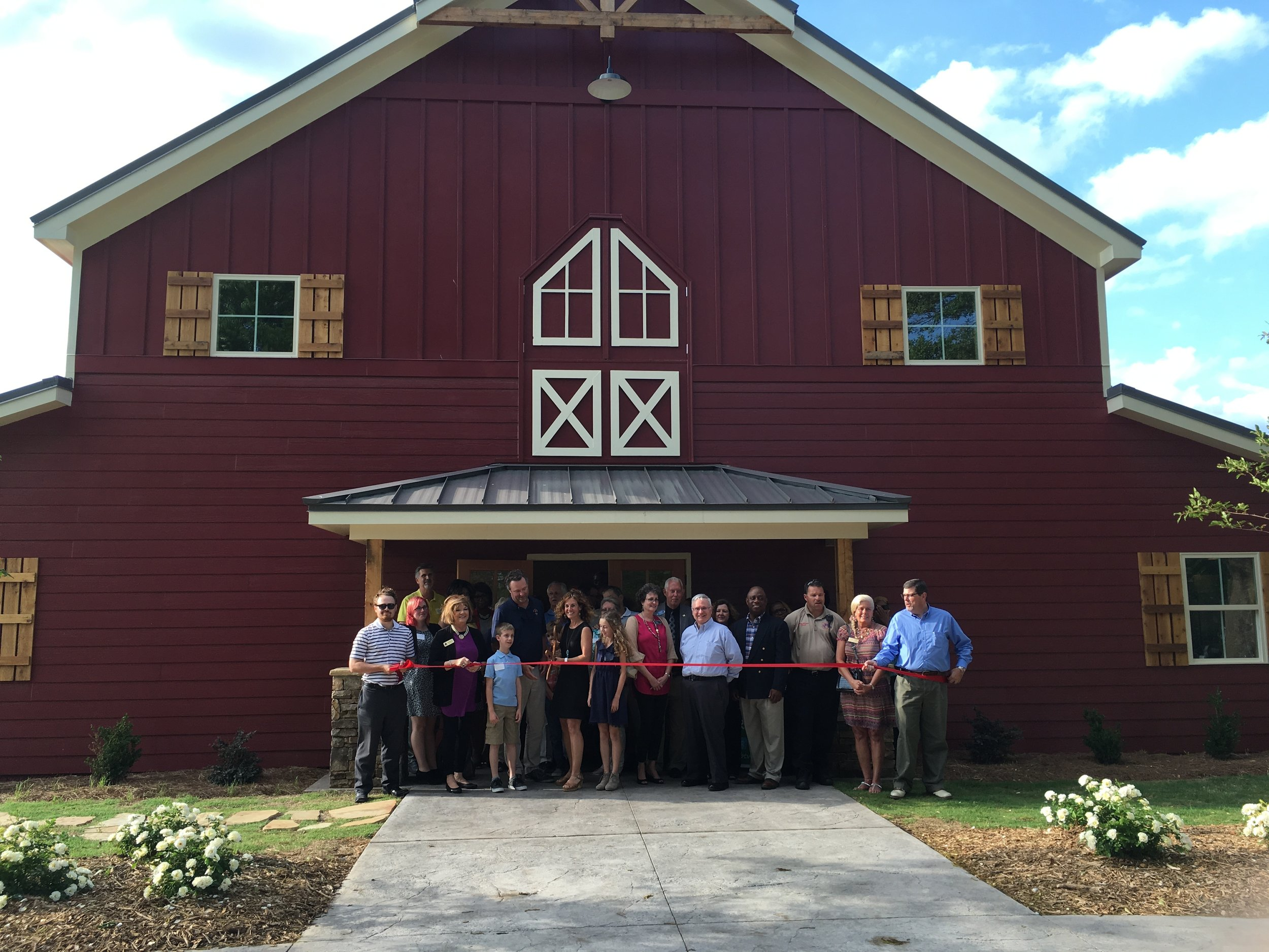 This was our ribbon cutting ceremony surrounded by family, friends and community! Such a special moment!