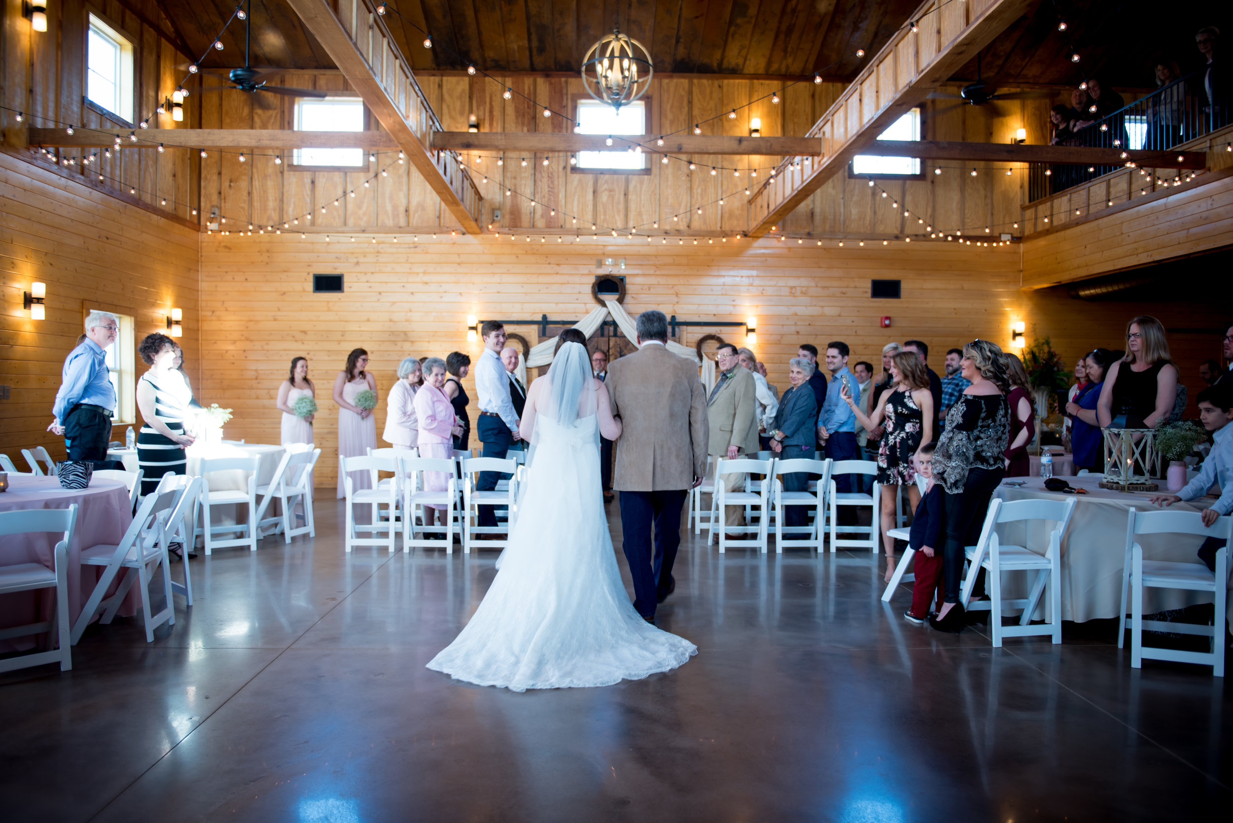 Indoor wedding ceremony at Pepper Sprout Barn. Photo by Brian Dean Photography.