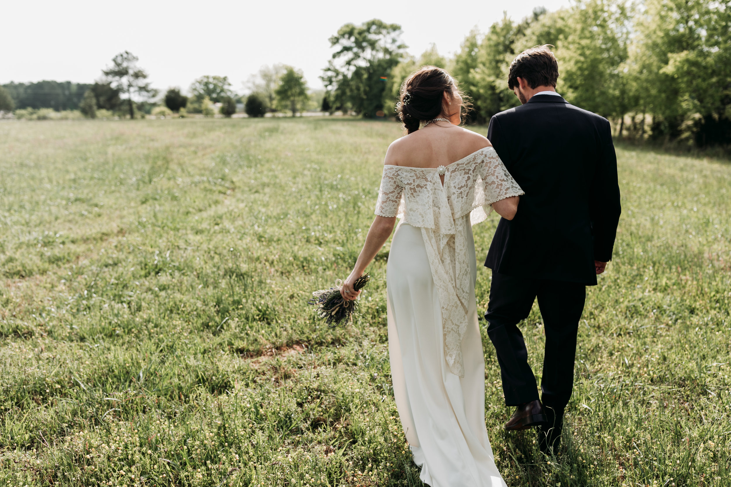Ronni and Jordan taking a walk in the field to soak in all the joys of the day. pc: Sydney Renee Photography