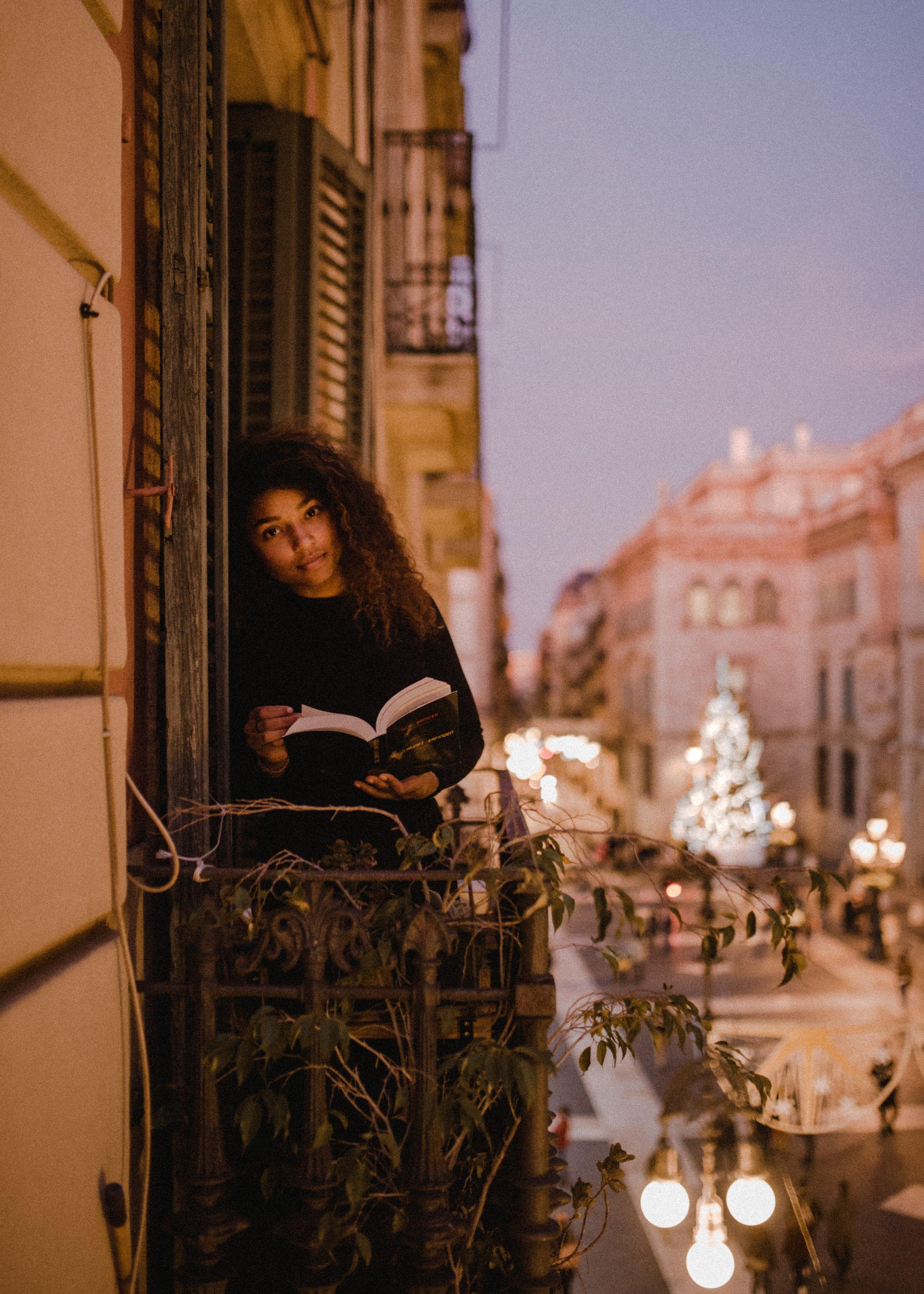 girl w book on terrace.jpg