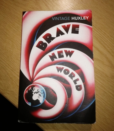 Huxley imagined a world where people are indoctrinated to consume products and services.