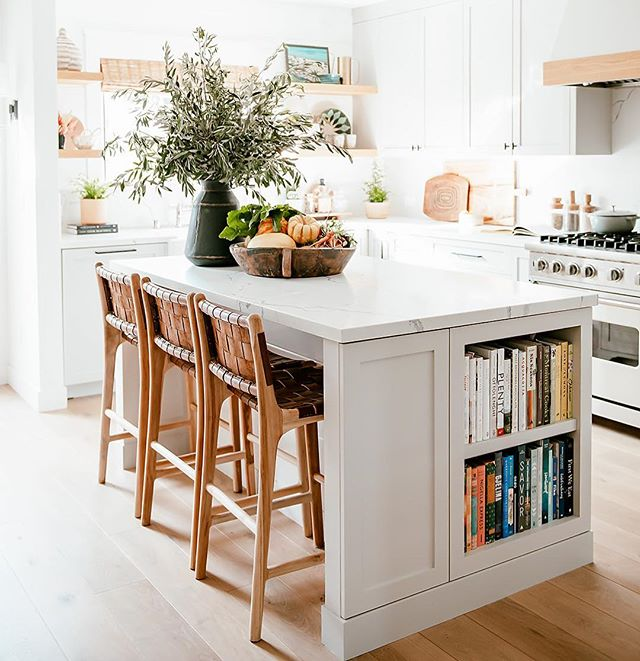 Love the look of this kitchen island with open ended shelving for cook books! #beechaveproject