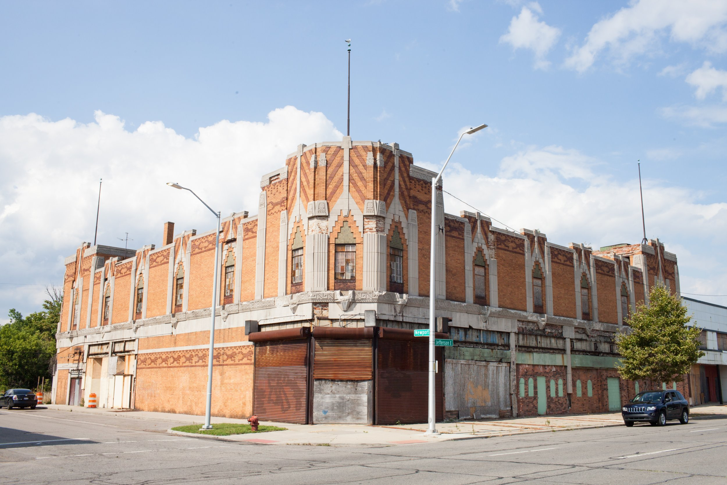 """Detroit residents are ready for the Vanity Ballroom to come back to life and serve the neighborhood as a destination attraction. On the National Register for Historic Places, the Vanity Ballroom is one of the last standing great ballrooms from Detroit's jazz era and a major anchor building in the Jefferson-Chalmers neighborhood.JEI and the City of Detroit are working jointly to secure funds to mothball this property and pioneer a """"tactical preservation"""" strategy to activate the ground floor retail space. In 2017, JEI continued necessary predevelopment work, including the completion of phase I & II environmental assessments, fnancial modeling, and storefront design.   Development Phase: Predevelopment: Phase I and II Enviromental Completed   Total Investment:  $12,000,000   Challenge:  $4.6M Unserviceable Debt Gap"""