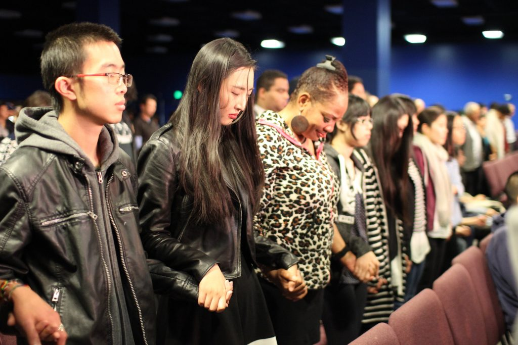 The participants offer a unison prayer for the peaceful reunification of North and South Korea.